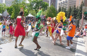 People dancing on street in colourful clothing