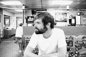 Bearded man looking left
