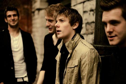 4 young men facing left
