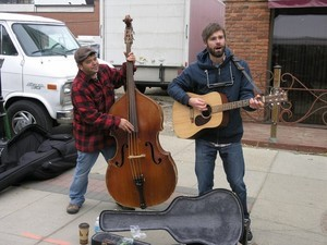 2 men playing guitar and double bass