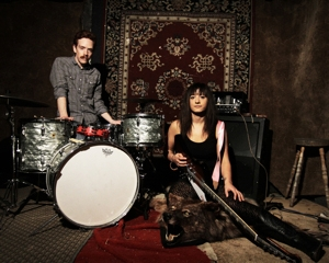 Man and woman in front of band instruments