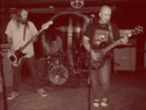 A 4-man band playing in a small club.