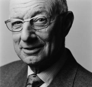 Portrait of distinguished, senior, smiling man with glasses