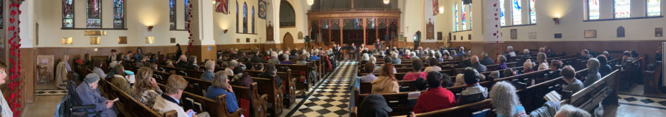 Panoramic image within church of quintet performing at front