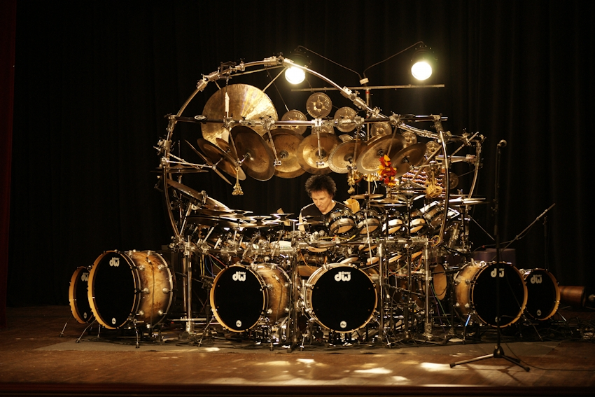 Numerous percussion and drum units around a central seat onstage