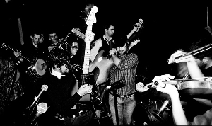 black and white photo of 2 guitarists and 2 fiddlers